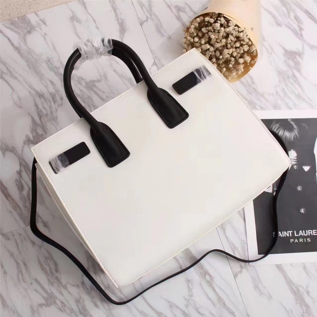 1b07dcdc0f Saint Laurent s sleek handbags imitation tote is crafted from the finest  white leather